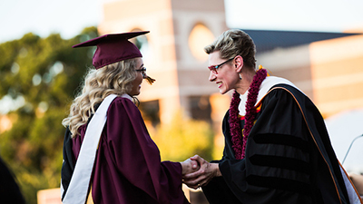Student graduating shaking hands with Dean